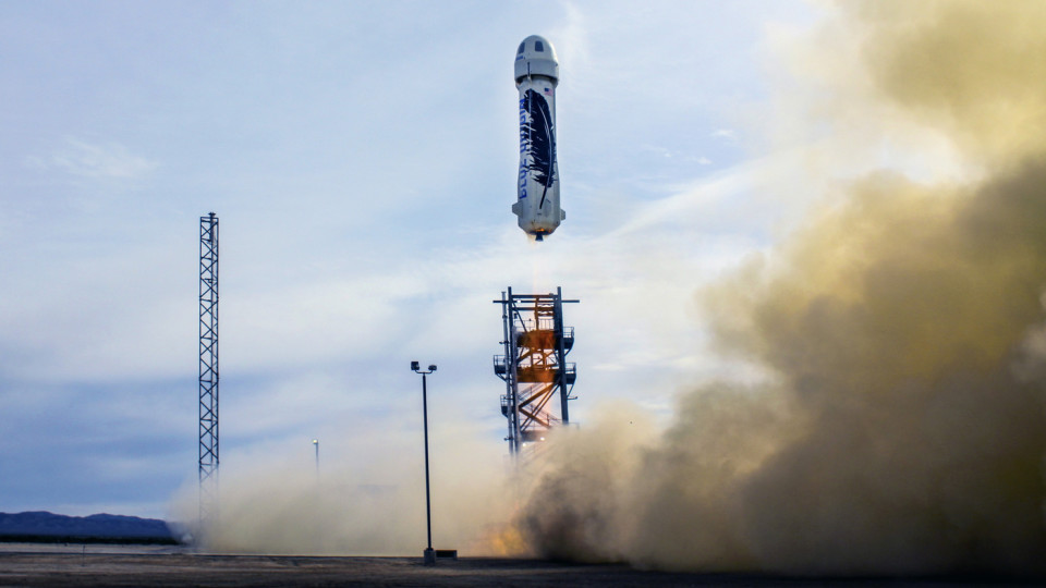 The New Shepard, seen here taking off with its capsule in place, returned to its launch site in a vertical landing after reaching an altitude of 100 kilometers.